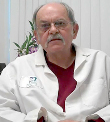 Dr. Ed Morgan sitting in labcoat