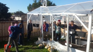 JCS students help move soil into new greenhouse