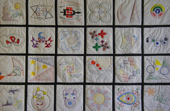Each quilt square design was digitized and then embroidered using a computer controlled embroidery machine.