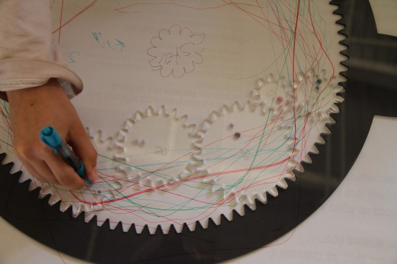 A close up of the spirograph track and gears.