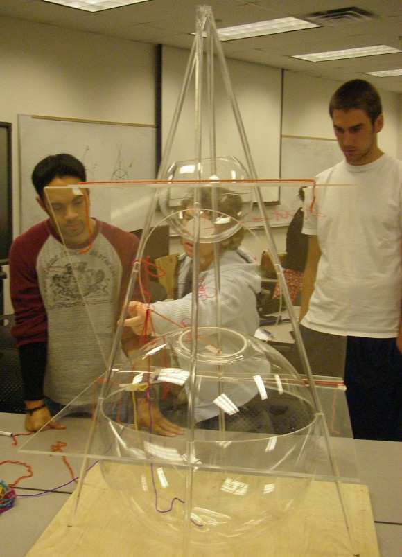 Taking advantage of the scale of the piece, students investigate properties of the ellipse.